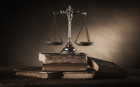 antique books: Old silver scale and hardcover books on a wooden table, justice and knowledge concept