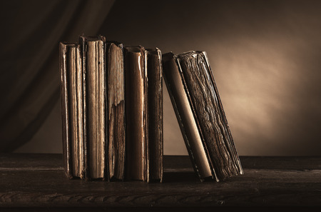 ancient books: Ancient books on a ruined old table still life, literacy and wisdom concept