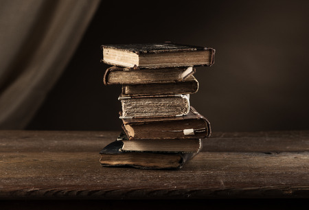 Pile of rare ancient books on an old table, wisdom and knowledge concept Stock Photo