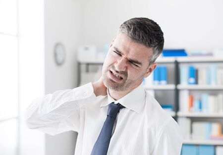 man at work: Sad businessman having neck pain symptoms, he is touching his neck, health care and illness concept Stock Photo