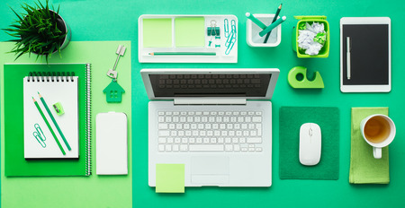 desk tidy: Green creative and eco-friendly desktop with laptop and office accessories, business and environmental care concept, flat lay Stock Photo