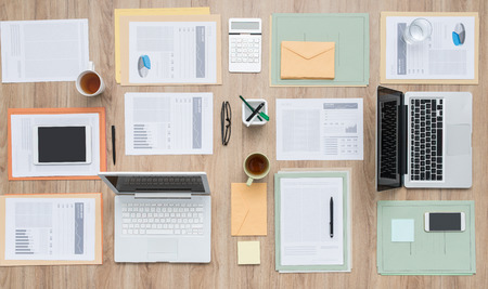 desk tidy: Business team office desktop with paperwork and laptops, flat lay Stock Photo