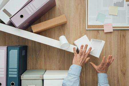 Shelf crashing and folders falling down on a office worker, failure and disaster concept