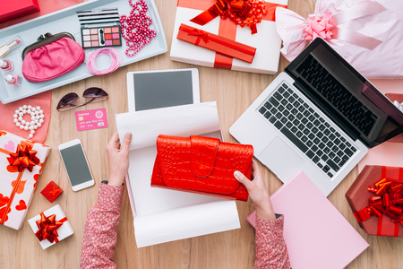 unwrapping: Woman unboxing a beautiful fashion bag in a gift box, online shopping and quick delivery concept Stock Photo