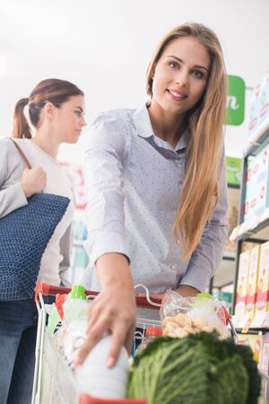 lifestyle shopping: Happy women shopping together at the supermarket, lifestyle and retail concept Stock Photo