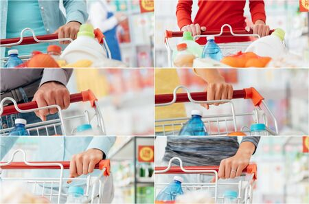 spending full: People doing grocery shopping at the supermarket and pushing a shopping cart, hands close up