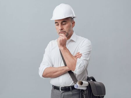 Construction engineer thinking with hand on chin, problem solving and solutions concept Stock Photo