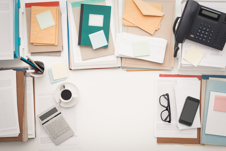 Full business desktop with paperwork and copy space, flat lay Stock Photo