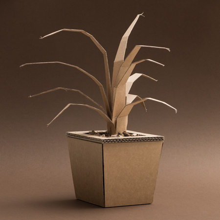 Decorative handmade plant in a vase made from recycled cardboard