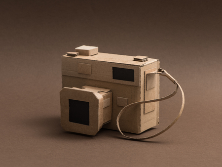 Creative handmade camera made from recycled cardboard, crafts and creativity concept