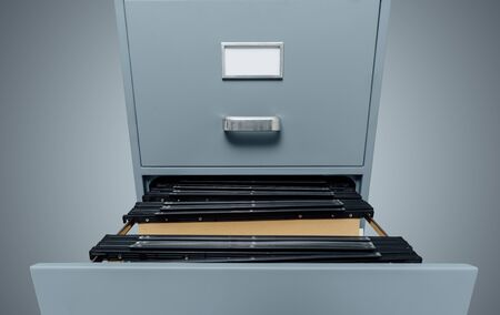 Filing cabinet with open drawer and files inside: data storage and archives Banco de Imagens - 85506268