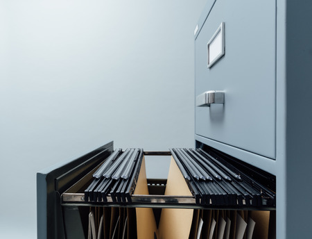 Filing cabinet with open drawer and files inside: data storage and archives 스톡 콘텐츠
