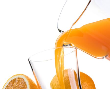 Pouring refreshing natural orange juice into a glass: nutrition and healthy drinks Stock Photo
