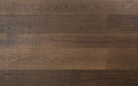 Elegant hardwood flooring made of dark textured wood planks Stock Photo