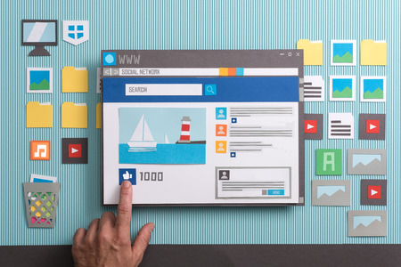 Social media post with comments in a browser window, a user is pressing the like button: social networks and community concept, collage and paper cut composition