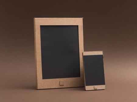 Creative digital tablet and smartphone made from recycled cardboard: creativity, ecology and crafts concept