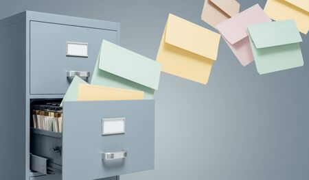 Fast files transfer into a filing cabinet: data storage, backup and archive concept Stock Photo