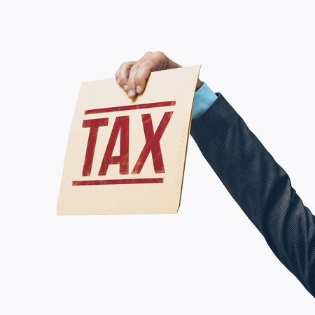 Businessman holding a tax file on white background, tax refunds and payments concept Stock Photo