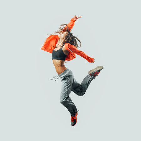 Athletic modern style dancer jumping, energy and fitness concept Stock Photo