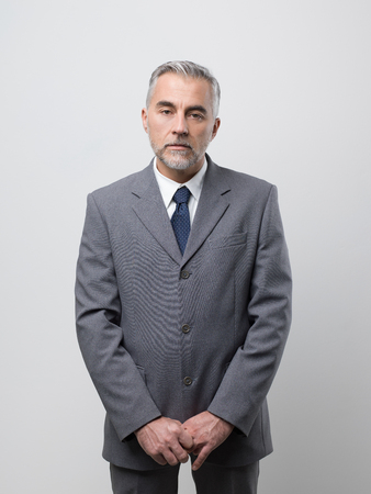 Confident business executive posing and looking at camera