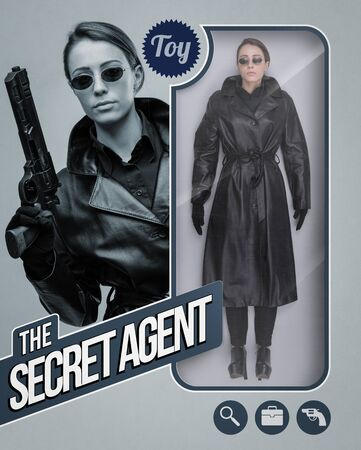 Female secret agent lifelike doll with toy see through packaging and character holding a gun Banque d'images