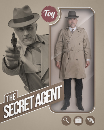 Secret agent realistic doll and toy see through packaging with character pointing a gun Banque d'images