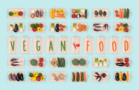 Vegan food and healthy eating: fresh raw vegetables on chopping boards collection and text