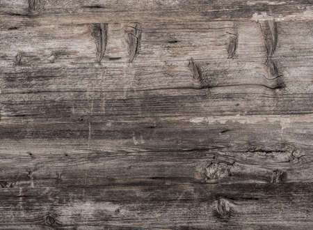 Weathered grungy wood background with textured surface Banque d'images