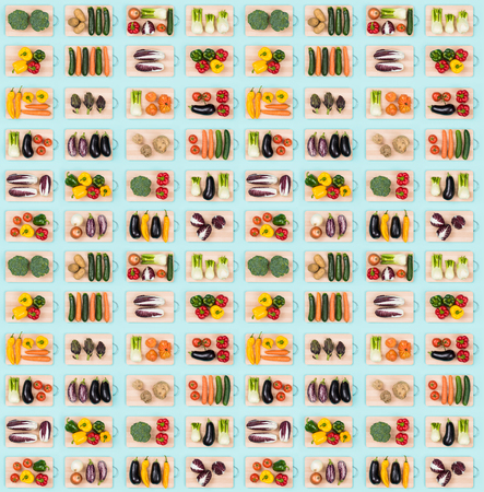 Colorful assortment of healthy vegetables on wooden chopping boards, food background