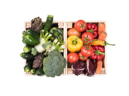 Fresh tasty colorful vegetables in wooden crates on white background Banque d'images