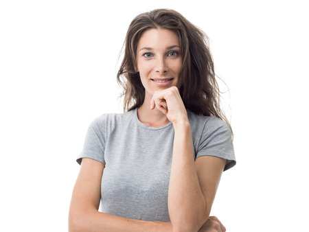 Beautiful sporty woman smiling and posing with hand on chin, natural look and confidence concept Stock Photo