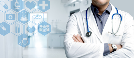 Confident doctor posing with arms crossed and medical icons interface, healthcare and technology concept