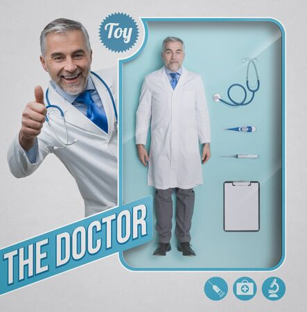 Realistic male doctor doll, accessories and toy see through packaging with smiling character giving a thumbs up