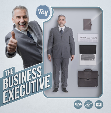 Business executive lifelike doll with see through toy packaging, accessories and smiling businessman giving a thumbs up