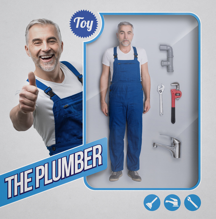 Realistic plumber and repairman doll with work tools and smiling character giving a thumbs up on the see through packaging Stock Photo