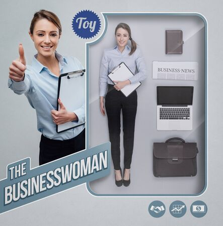 Businesswoman lifelike doll with toy see through packaging, accessories and smiling character giving a thumbs up Stock Photo