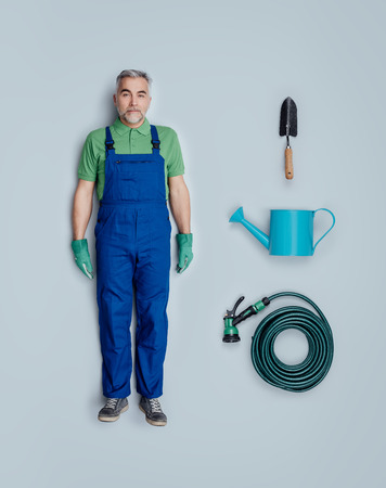 Professional gardener lifelike toy doll with overalls and gardening tool accessories, flat lay