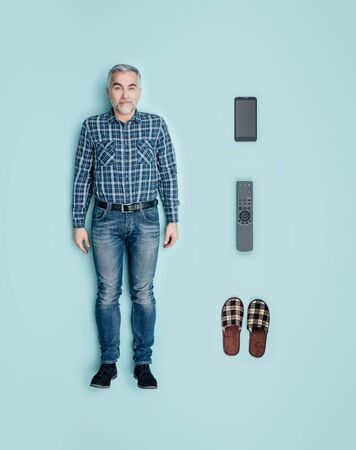Lifelike male doll with leisure and relax accessories: smartphone, tv remote control and slippers