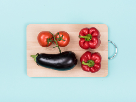 Fresh seasonal organic vegetables on a wooden cutting board, food preparation and healthy eating concept