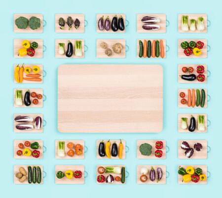 Fresh raw healthy vegetables on wooden chopping boards frame and copy space at center, healthy eating concept Stock Photo