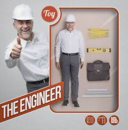 Lifelike engineer and architect doll, accessories and see through packaging with smiling character giving a thumbs up Stock Photo
