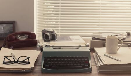 Writer, journalist and photoreporter vintage desktop with typewriter, camera and record player Stock Photo