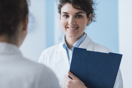 Professional doctors meeting in the office: healthcare and medicine concept