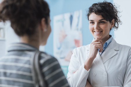 Doctor meeting a patient at the clinic for a medical consultation, healthcare and medicine concept Stock Photo