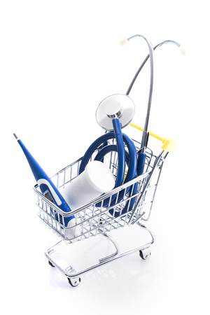 Medical equipment supplies in a shopping cart: medical accessories shop and home healthcare items concept