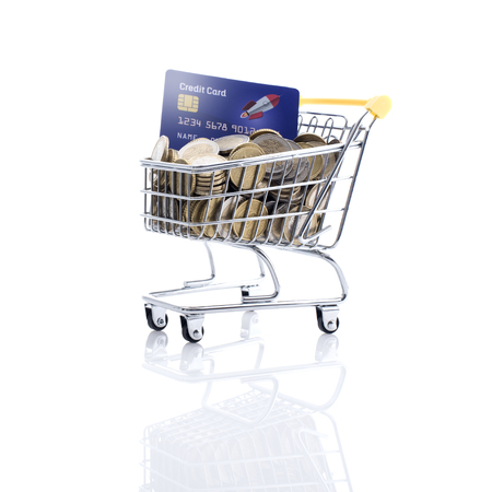 Shopping cart full of money and credit card: retail, payment and banking concept