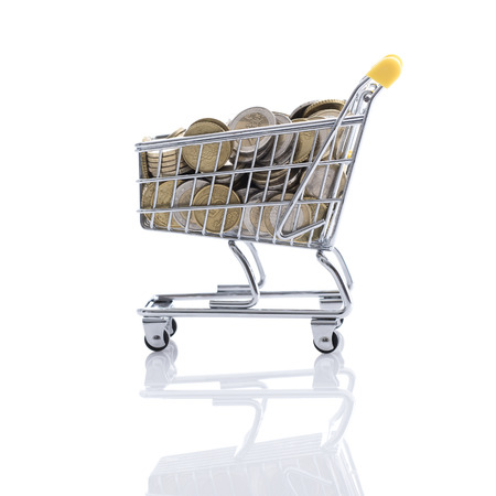Supermarket shopping cart full of money on white background: retail, price and savings concept