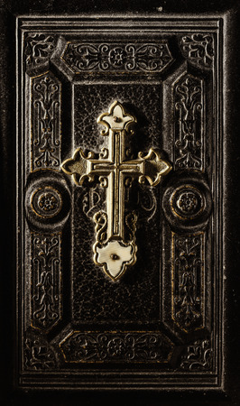 Precious antique Bible cover with golden cross and decoration, religion and spirituality concept Editorial