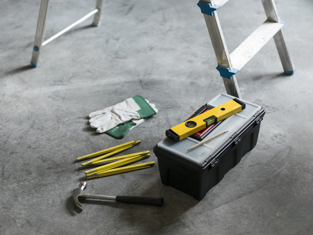 Hardware tools on the floor: home renovation, construction and do it yourself concept