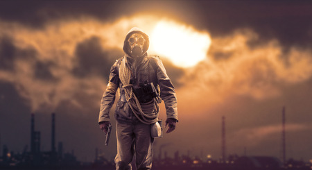 Brave post apocalyptic survivor with gas mask and a gun; polluting industries, toxic smog hiding the sun and environmental degradation in the background Stock Photo - 108248659